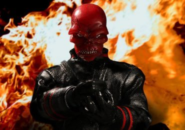 Mezco Toyz One:12 Collective Red Skull action figure, with flames behind