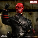 Mezco Toyz One:12 Collective Red Skull action figure, posed with raised fist