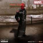 Mezco Toyz One:12 Collective Red Skull action figure, posed with closed mouth portrait